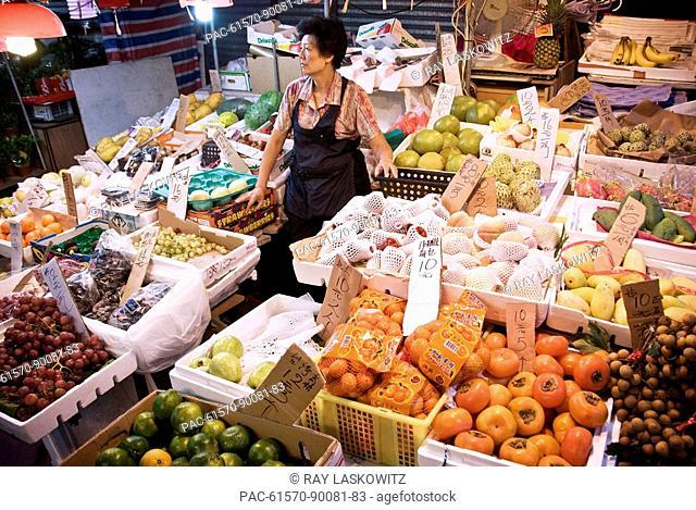 Hong Kong, Central SOHO, Fresh fruit and vegetable seller at the Graham Street Wet Market