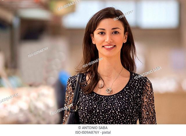 Portrait of woman in market