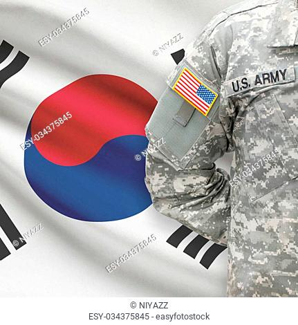 American soldier with flag on background - South Korea