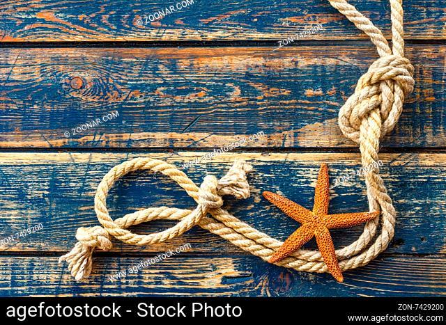 Sea background with starfish and marine rope