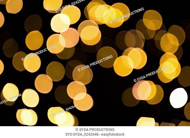 blurred golden lights over dark background