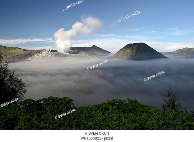 Active crater of Mount Bromo left and Mount Batok right, Bromo Tengger Semeru National Park, Island of Java, Indonesia