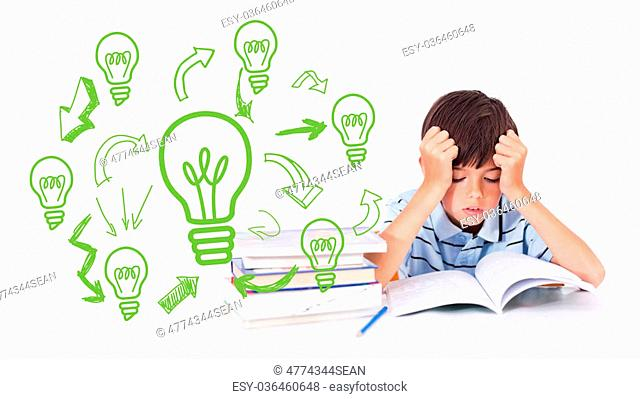 Idea and innovation graphic against cute pupil reading at desk
