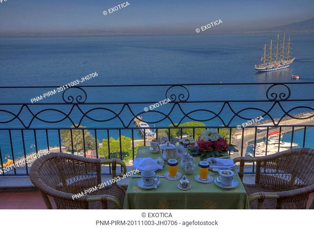 Place Setting at the terrace of a hotel with the sea in the background, Sorrento, Campania, Italy