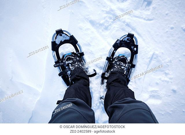View from above of man in snowshoes. Dovrefjell-Sunndalsfjella National Park. Norway