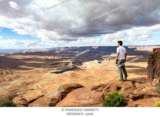Man overlooking the landscape in Canyonlands National Park, Moab, Utah, United States of America, North America