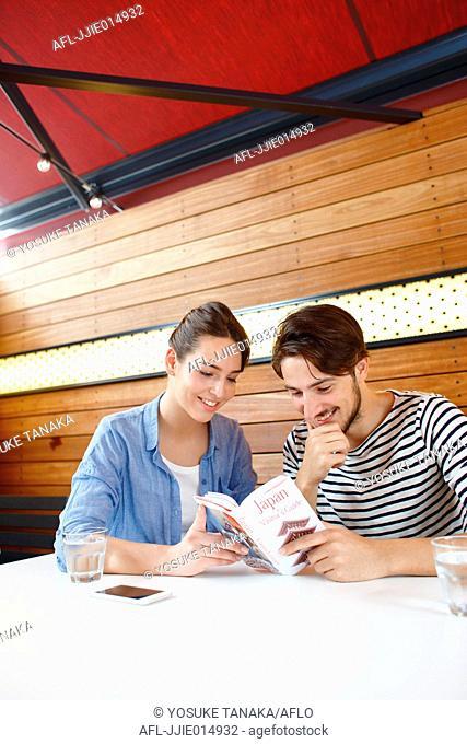 Caucasian couple enjoying Japanese food in Tokyo, Japan