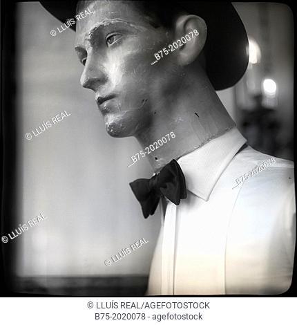 old male mannequin in a shop window of Bates hat shop in Rue de Rivoli, Paris, France