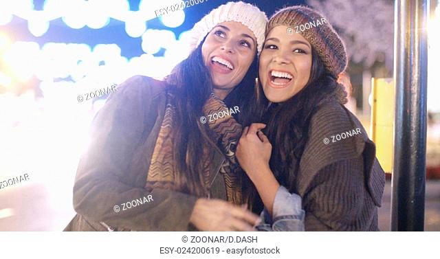 Two vivacious young women laughing and having fun