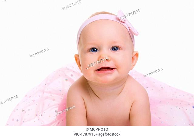 Portrait of adorable baby girl showing her first teeth. Isolated on white - 01/01/2009