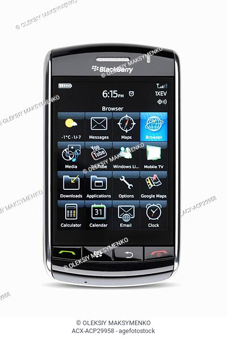 BlackBerry Storm 9530 touch screen smartphone with illuminated display isolated on white background with clipping path