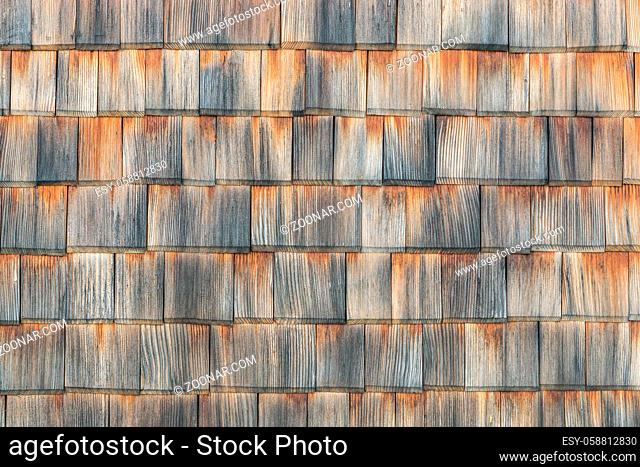 Shingle aged wooden wall roof background with copyspace, Weathered shakes with nice colored texture