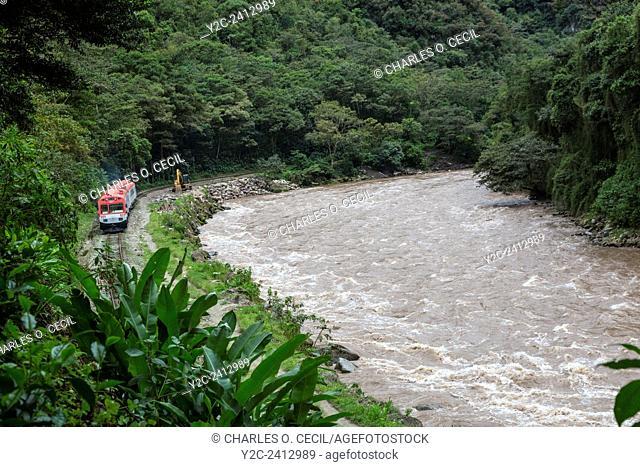 Peru, Machu Picchu Pueblo. Train Returning to Ollantaytambo, Urubamba River on Right