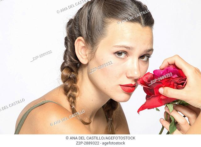 Close up of mid-adult woman smelling rose