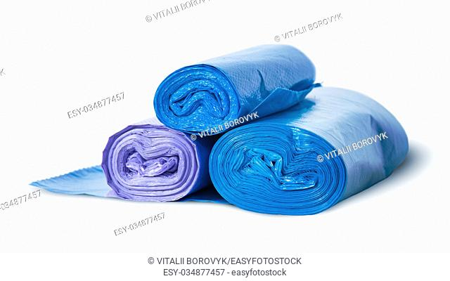 Three rolls of plastic garbage bags rotated isolated on white background