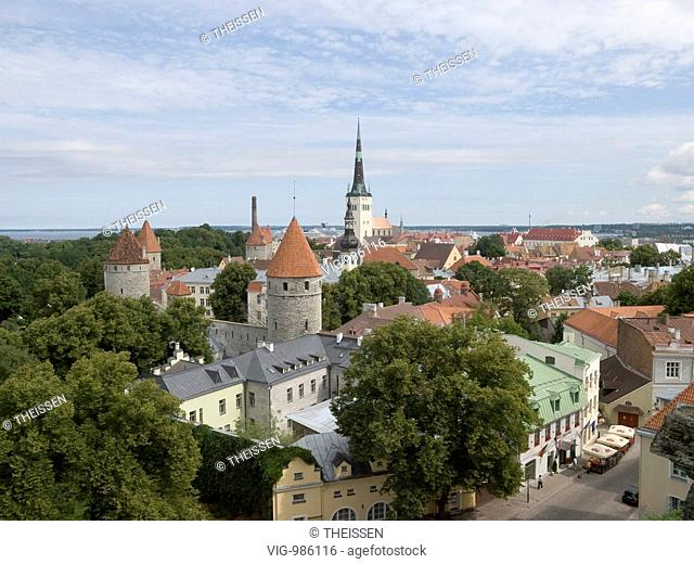 overview over the old town of Tallinn with the old city wall with several watch towers and steeple of the Saint Olav's church