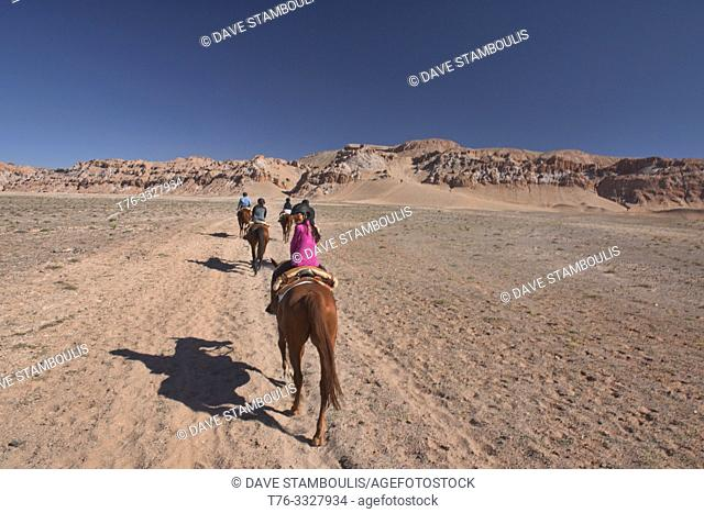 Travelling by horse in the Moon Valley, San Pedro de Atacama, Chile