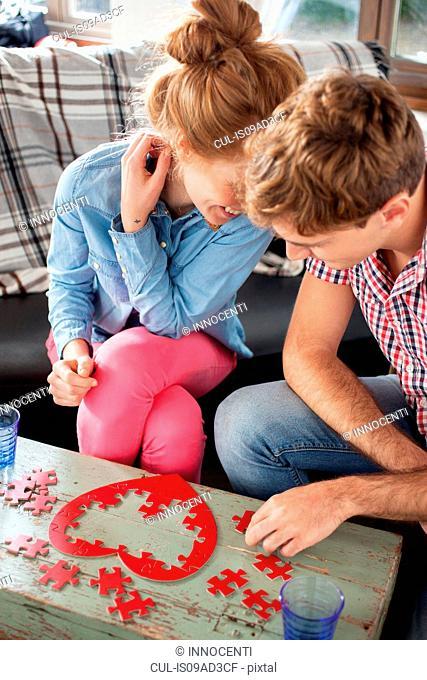 Couple doing heart shaped jigsaw