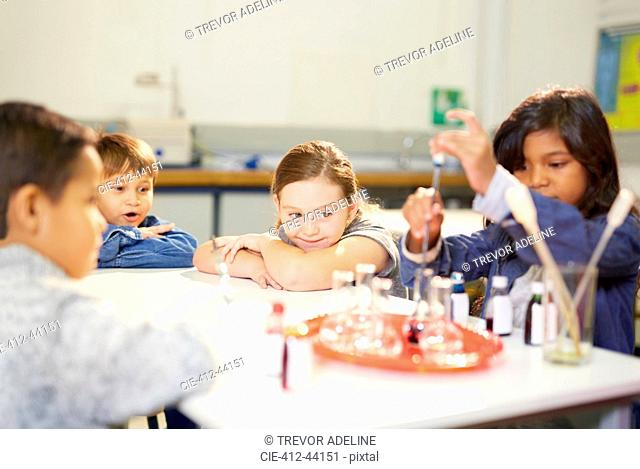 Curious kids conducting science experiment