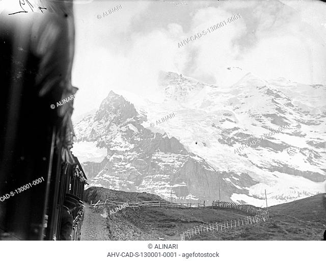 View of the Jungfrau mountain from the carriage of a train, shot 06-07/1905 by Monteverde, Aurelio