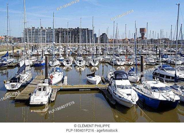 Sailing boats, motorboats and pleasure yachts in the marina at seaside resort Blankenberge along the North Sea coast, West Flanders, Belgium