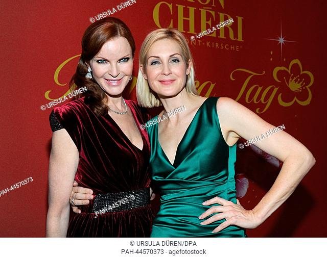 American actresses Marcia Cross (L) and Kelly Rutherford arrive at the Postpalast for the gala to celebrate the Barbara Day in Munich, Germany, 04 December 2013