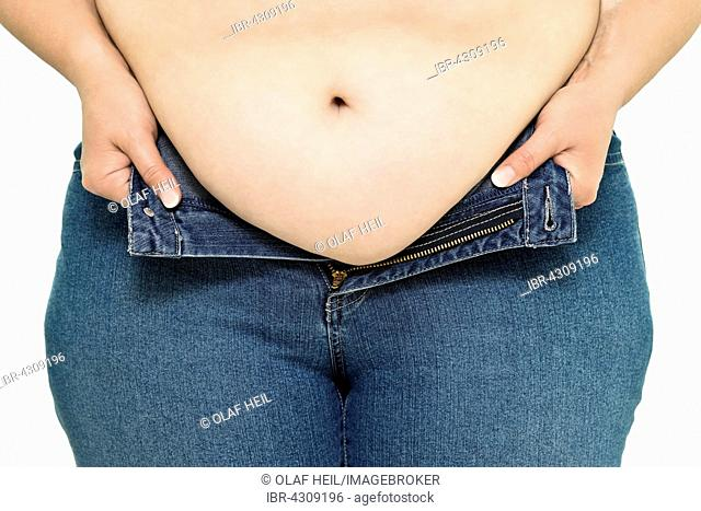 Overweight woman with big belly, pants are too tight, Germany
