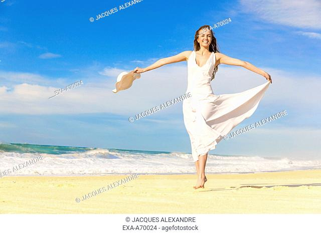 woman dancing at beach