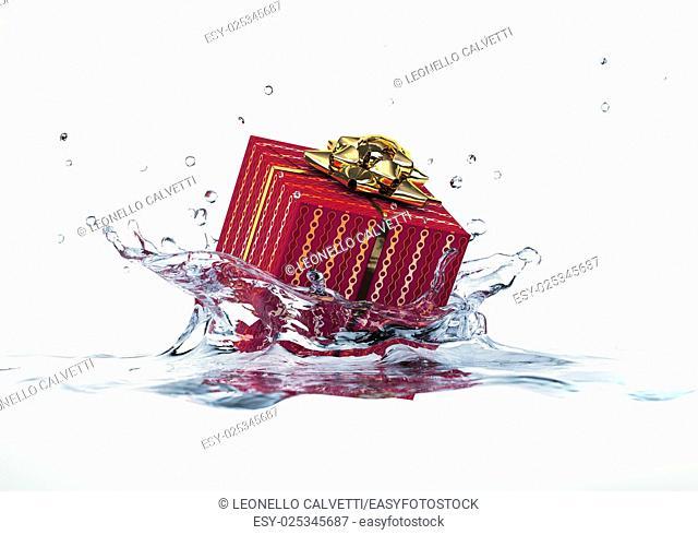 Decorated gift falling into water splashing. On white background