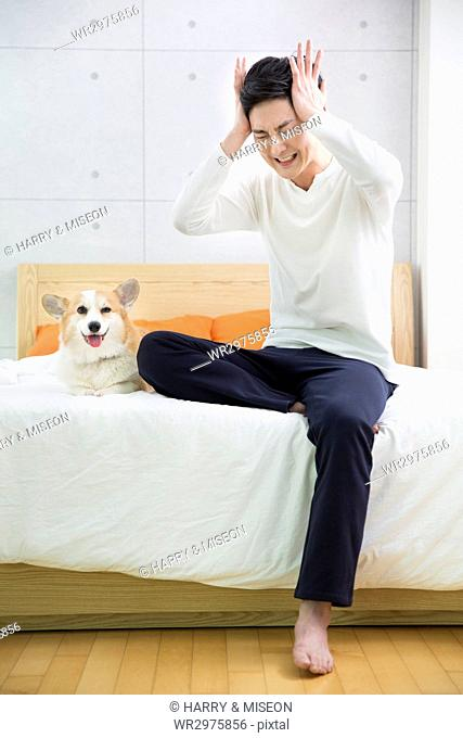 Young stressful bachelor and his pet dog