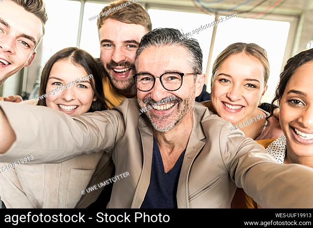 Group portrait of happy business people in office