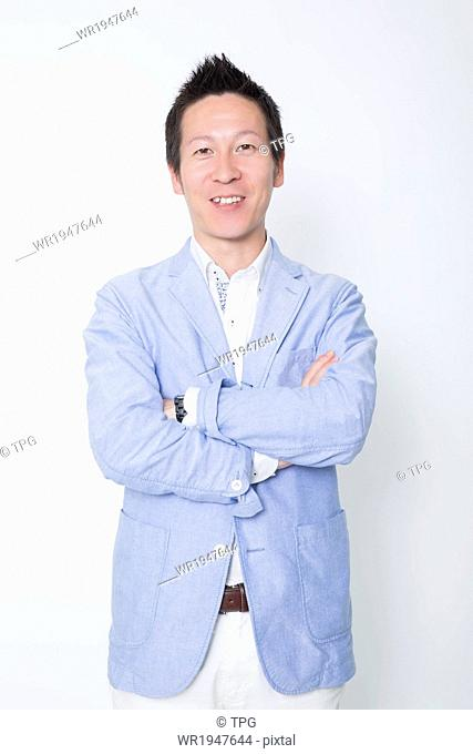 Businessman Standing with Arms Folded