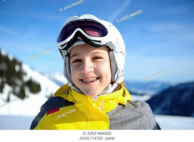 Teenage girl smiling on skiing holiday, Tirol, Austria, Europe