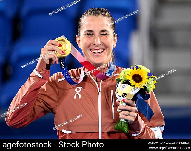 31 July 2021, Japan, Tokio: Tennis: Olympics, women's singles: Olympic champion Belinda Bencic of Switzerland cheers with her gold medal at the award ceremony
