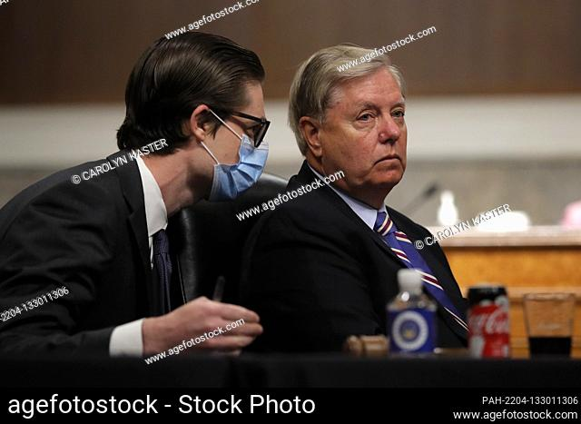 United States Senator Lindsey Graham (Republican of South Carolina), Chairman, US Senate Judiciary Committee, speaks with an aide during a US Senate Judiciary...