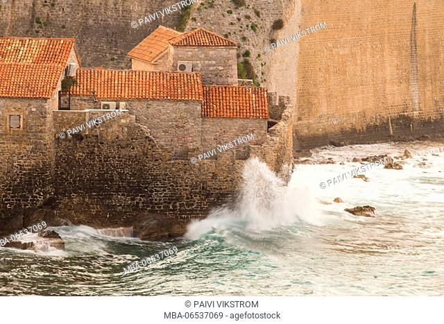 Waves of Adrian's sea hit to the walls of the Old Town Budva, Montenegro