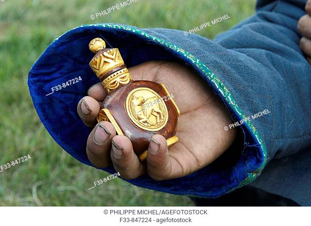 Man with snuff bottle, Mongolia