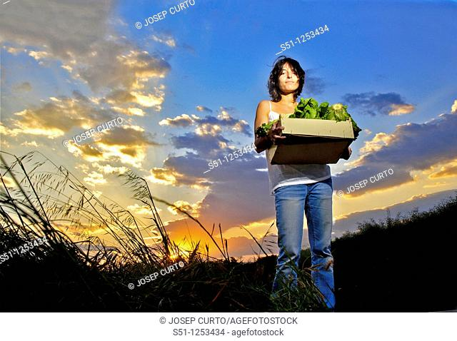 Girl with lettuce box