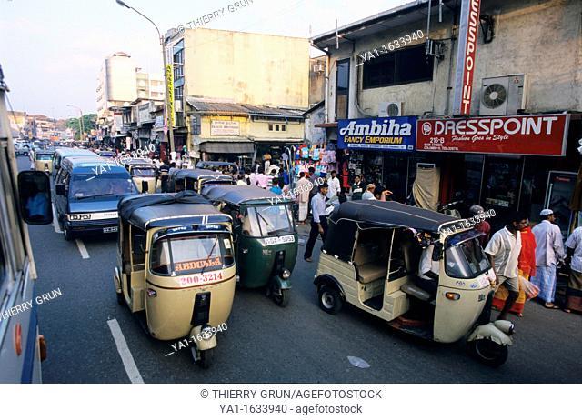 Crowded street with typical tuktuks, 216 Main Street, Colombo 11 (Pettah), Sri Lanka