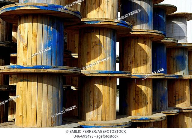Copper cable wooden rolls. Lleida, Catalonia, Spain