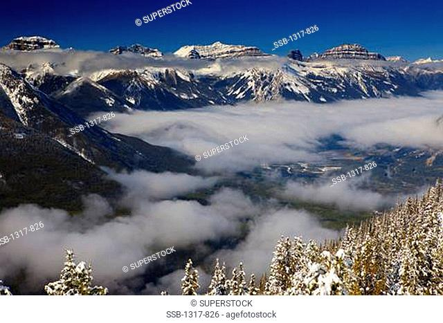 Mountains surrounded by clouds, Sulphur Mountain, Banff, Banff National Park, Alberta, Canada