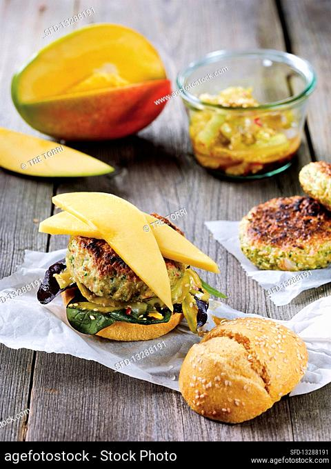 Prawn burger made in a Beefer with a mango, sesame seed and cucumber salad