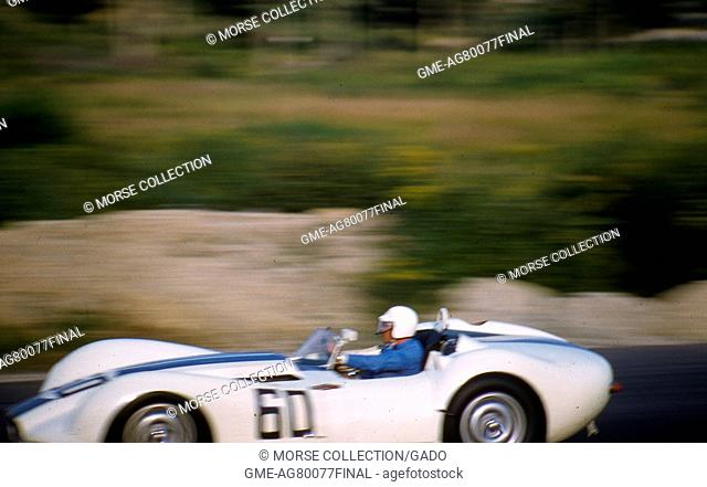 Action view at speed of the Lister-Jaguar prototype Knobbly No. 60 race car, driven by Walt Hansgen during the Sports Car Club of America's SCCA National Races...