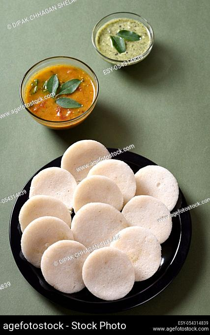 Idli with Sambar and coconut chutney, Indian Dish : south Indian favourite food rava idli or semolina idly or rava idly, served with sambar and green chutney