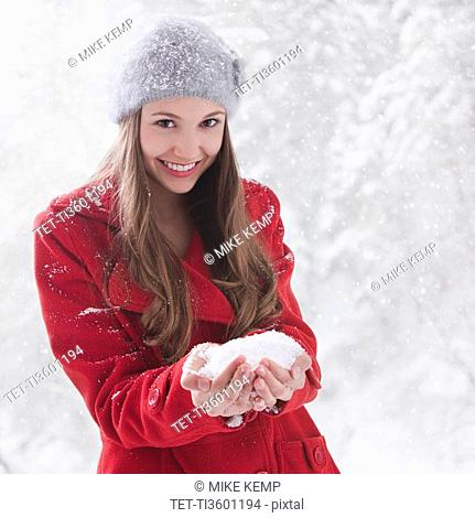 Woman holding snow in her hands