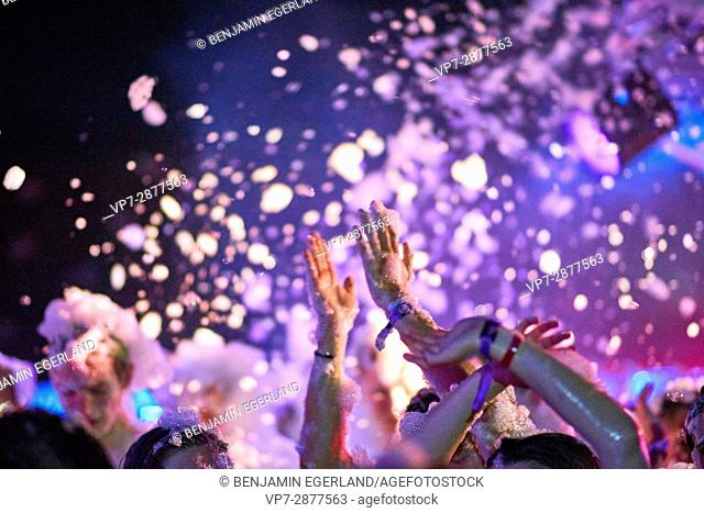 Hands and foam at music festival in party destination