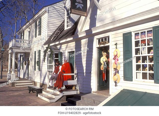 Colonial Williamsburg, Virginia, VA, Williamsburg, Interpreters wearing colonial costumes stand outside a village store in Colonial Williamsburg