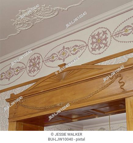 Close-up of intricately carving on maple door frame ceiling plaster embellishments