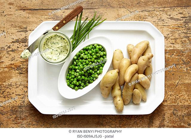 Fingerling potatoes and spring peas served with a chive compound butter