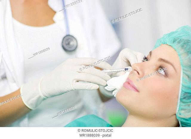 Woman Getting A Botox Injection On Her Face
